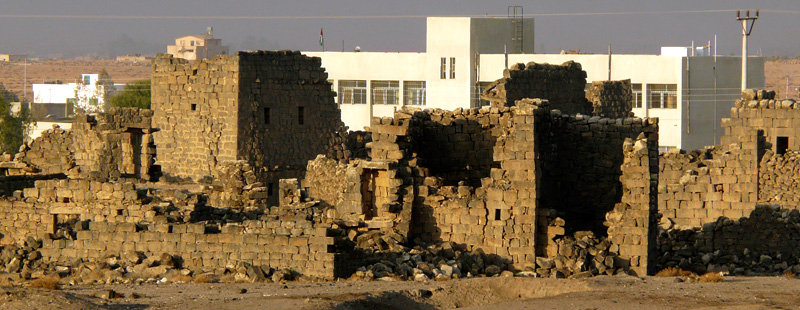 Main image: Ruins along the western edge of the ancient Byzantine and early Islamic town are located adjacent to the local boys' school, part of a modern community of several thousand surrounding the historical site.